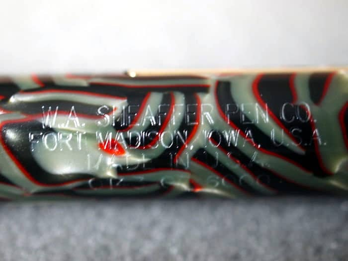 Detalle del grabado de la pluma